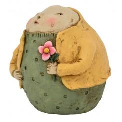 Figur, mand m. gul jakke og blomst